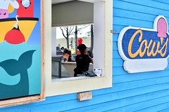 Ice cream, please! (halifaxlight (mostly off in July)) Tags: canada novascotia halifax foodbooth icecream cows window customer colourful sunny logo decoration salesperson