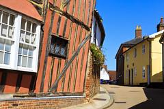 Lavenham, Suffolk (Boganeer) Tags: lavenham suffolk england unitedkingdom beam tudor canon canoneos canon6d house building pattern stripe window pink suffolkpink slant lean