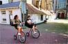 Strange Way to Cycle (Hindrik S) Tags: bike bicycle fyts fiets rad fahrrad two social duo twa zwei deux girls dames froulju vrouwen ladies streetphoto street streetphotography strjitfotografy strjitte strasse straatfotografie straat deventer lebuïnus kerk overijssel oerisel candid tourist toerist sony1650mmf28dtssm sal1650 sonyphotographing sony sonyalpha alpha a57 α57 slta57 2018