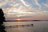 Fishing as the sun goes down (danielhast) Tags: madison wisconsin sky clouds sunset lakemendota lake mendota water pier people fishing tree