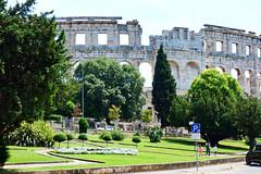 Pula: Initial Glimpse of Roman Arena (ARKNTINA) Tags: pula pulacroatia istria istra europe croatia hr18 eur18 random6 town building architecture arena amphitheater pulaarena romanamphitheater romanarena romanruins ruins