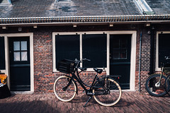 Classic Bike (Octal Photo) Tags: 500px netherlands old town cathedral gothic bell tower clock minster church steeple landmark architecture historic castle brick bike retro door windows window hipster bicycle street classic haarlem noordholland