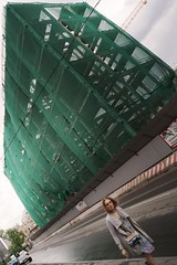 it just fit... (f_lynx) Tags: sonya9 sonyfe282 flynx lady girl look passing building green moscow russia shadows fun color 2x3 street construction wet reflections sky hair wind face people