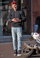 IMG_9370 (Skinny Guy Lover) Tags: outdoor candid guy man male dude jeans bluejeans cap winterjacket handsome handsomeguy handsomeman smiling fun walking sneakers motorcycle bike scooter