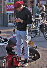 IMG_9365 (Skinny Guy Lover) Tags: outdoor candid guy man male dude jeans bluejeans cap winterjacket bag backpack smartphonezombie smartphone motorcycle bike scooter