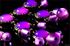 Precious Purple (iecharleton) Tags: smileonsaturday preciouspurple jewelry stones gem purple pendant necklace gold blackbackground semiprecious detail macro