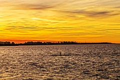 In the afternoon (Wal Wsg) Tags: intheafternoon afternoon sunset atardece atardecer atardeceres 7dwf 7dwfsaturdayslandscapes ca canoneosrebelt3 dia day argentina argentinabsas buenosaires caba capitalfederal riodelaplata river water agua naranja orange phwalwsg photography photo