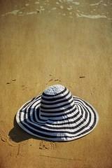 Sun hats and sand (alideniese) Tags: smileonsaturday hatsandco hat beach sand stripes sunhat warm sunny alideniese light shadow sunlight texture colour wetsand