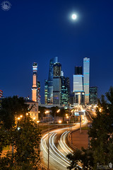 Moskva-City Skyscrapers and Car Light Trails Under Moonlight (Guide, driver and photographer in Moscow, Russia) Tags: businesscenter cityscape framedbytrees mibc modernarchitecture moscow moscowcity moscowbynight moskva moskvacity nightcity nightmoscow russia twilight moonlight skyline skyscrapers ru