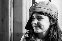 Naomi (NikNak Allen) Tags: portrait face eyes hair cap hat grey black white blackandwhite blackandwhiteportrait girl child close light shadow
