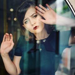 Behind the Wall of Glass (Monika Schiefer) Tags: girl frau women glas 50s kleid dress hands schaufenster mood lips ambient light natural beauty venedig venice spring frühling streets