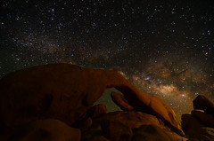 Milky Way Rising (Craig Stevens <castevens12>) Tags: nikond7000 tokina1116mmf28 astronomy astrophotography space galaxy milkyway stars bright arch rock stone mountain joshuatreenationalpark mojavedesert highdesert lightpainting