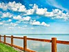 Don't fence me in.. (Hope2b) Tags: hss sliderssunday genevaonthelake lakeerie lake water fence clouds vivid