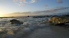 Surf at Sunrise......and my first ever Explore!  Thanks everyone. (Stickwork-Steve) Tags: explore sonyflickraward mexico mayanriviera rivieramaya playa surf waves ocean sea seascape rocks wave playabarcelo sky clouds sunrise sony sonya7ii sonyfe24240mm