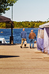 Two Men Carrying Bread Bags At The Market (k009034) Tags: 500px water copy space finland oulu scandinavia tranquil scene bag bread carrying city couple forest look man market pier plastic post sea senior shadow sign street summer tent town two walking teamcanon copyspace tranquilscene plasticbag