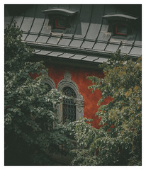 A Mystery Inside (Thomas Listl) Tags: thomaslistl color faded 100mm orange green house architecture windows roof trees nature detail mood atmosphere dark mystery mysterious