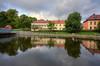 Black River Morning (henriksundholm.com) Tags: landscape clouds cloudy sky reflections daylight svartån lake park bridge lawn grass railing city urban morning hdr västerås sverige sweden