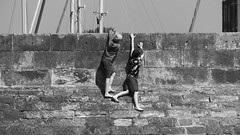Wall scaling monkeys (byronv2) Tags: boy boys kids children climbing wall play playing dangling candid street peoplewatching harbour harbourwall fisherrow musselburgh edinburgh firthofforth rnbforth rnbfirthofforth forth riverforth river sea northsea coast coastal beach