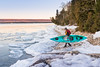 Man prepares to launch kayak in icy Ontario lake (blurMEDIA Stock) Tags: brucepeninsula canada earth georgianbay ontario pfd active carpediem challenge climate climatechange determination environment environmental exercise fitness frozen fun globalwarming goodlife happy health healthy ice icy journey kayak kayaking lake lifejacket lifestyle living north northern outdoor perserverance planet refreshing rejuvenation relaxation retreat safety seasons skill solitary solitude sport warming winter wintersport