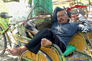 Rickshaw driver's power nap at Sumenep, Madura