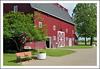 Rest Awhile by the Big Red Campania Barn (sjb4photos) Tags: gilmorecarmuseum michigan hickorycorners bench benchmonday hbm campaniabarn