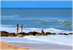 Day at the Beach (Chris C. Crowley) Tags: dayatthebeach marineland florida jetty women bikinis waves ocean atlanticocean beach horizon sea sand rocks boulders people