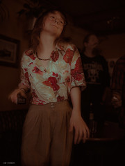 dancing girl (sami kuosmanen) Tags: tampere suomi finland vastavita yläkerta pub night yö music musiikki dance tanssi gig keikka show nainen bokeh beautiful travel tumma tyttö girl flower shirt red light long hair hauska funny fun europe exposure expression emotion glasses silmälasit eye happy joy