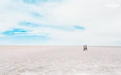 Tiny travelers (Mando Cast) Tags: departamentodepotosí bolivia bo amazing south america bolivian mandocast mandocastphotography mandocastphoto armandocastanon uyuni salar uyunisalar artic antartic white people couple tiny peruvian nature landscape blue sky azzurro road walking wanderlust clouds cloudy day daylight plain r symmetry