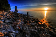 Cairns Along the Shoreline (Tom Mortenson) Tags: geotagged morning dawn shoreline greatlakes lakemichigan wisconsin valmy valmywisconsin doorcounty sunrise rockyshore usa america unitedstates northamerica glow digital canon canoneos 1740l canon6d landscape lake midwest cairns piledrocks caviardreams