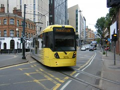 Manchester Metro Tram leaving Piccadilly Station (rossendale2016) Tags: conductor signal platform tickets cheap free passengers travel centre transport driver trumpet horn sign warning transverse roadway road tracks line tunnel tram yellow station piccadilly city media manchester