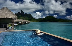 Pool with a View (Bora Bora) (Harald Philipp) Tags: architecture outdoors rural seascape landscape forest natural scenic people woman balcony terrace terrasse deck pool swimmingpool roomwithaview thatchedroof hotel ocean sea lagoon bay water mountain hill paradise holiday vacation tourism luxury tourist exotic tropical tropics tropicalisland destination travel adventure island beautiful romantic nikon nikkor d810 daytime light day cloud clouds cloudy southpacific tahiti borabora pacificocean hat