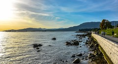 On the brightside (Christie : Colour & Light Collection) Tags: seawall ocean vancouver bc sunset sun light stanleyparkseawall shore coastline coast shoreline beach ships mountains canada walkway path people walkers sky clouds northamerican pacificnorthwest rocky rocks stones brickwork englishbay
