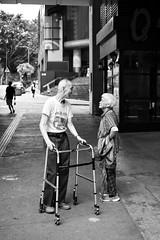 (perryge) Tags: hongkong people urban city blackandwhite voigtlanderheliarcollapsible50mmf35101stanniversaryedition voigtlander candid oldman oldwoman friends talking streetphotography 50mmf35heliar