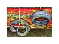 Tenby Rubber (CJS*64) Tags: boat rubber tyre tyres harbour water red colour colours dslr d7000 24mm85mmlens cjs64 craigsunter cjs pembrokeshire tenby dock docks moorings nikon nikkorlens nikkor nikond7000