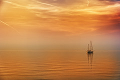 OK, That's It, I'm Leaving (Alfred Grupstra) Tags: sea sailboat nauticalvessel sailing sunset yacht nature water sky summer vacations outdoors travel sail sunlight sailingship dusk tranquilscene sun coastline