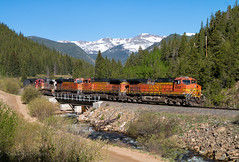 Rocky Mountain Way (Wheelnrail) Tags: bnsf burlington northern santa fe ge c449w hpvoden union pacific up railroad rail road moffat tunnel subdivision rocky mountains snow cap peaks train trains locomotive tree forest mountain car landscape sky