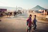 Camel Camp (*trevor) Tags: asia camel camelcamp children fujifilm india pushkar travelphotography xt2 cattle road