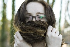 Gag Order (Chris B Richmond) Tags: hair outside outdoor outdoors curls woman girl lady pretty feminist feminism nature trees portrait face glasses eyes silence symbolism dslr canon closeup