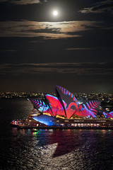 By the light, of a silvery Moon .... (OzzRod (on the road again)) Tags: pentax k1 smcpentaxfa77mmf18ltd vivid sydney light festival night lights moon moonlight cloud corona sydneyoperahouse sydneyharbour shadows uncropped dailyinmay2018