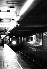 IMG_3054 (jumppoint5) Tags: blackandwhite light street shadows silhouette urban osaka train city contrast japan