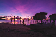 Beautiful sunrise... (Syahrel Azha Hashim) Tags: horizon cloudscape nature tokina fishingvillage holiday nopeople simple morning housesonstilts beach silhouette dramaticsky ultrawideangle earlymorning island sabah boat dof house woodenhouse denawanisland landscape asia simplelife nikon getaway d300s rarecation colorimage vacation residential slowshutter light longexposure naturallight semporna colorful ocean beautiful travel syahrel sunrise tropicalisland colors details malaysia sandybeach clouds detail