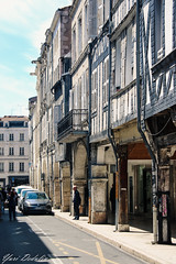 Narrow street of the old town, La Rochelle, France (Yuri Dedulin) Tags: 2018 architecture beautiful buildings charm culture eu enjoy europe france history holiday larochelle landscape medieval narrow narrowstreet oldcity shopkeepers stores street travel vacation weekend yuridedulin ancienttown na
