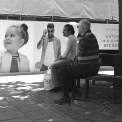 Watch this space (D John Walker LRPS) Tags: sunglasses norwich norfolk uk watching men girl black white bench resting shade