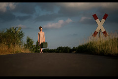 Changing Directions (fehlfarben_bine) Tags: nikond800 sigmaart500mmf14 portrait woman road traincrossing rural country landscape goldenhour intersection luggage baggage horizon berlin