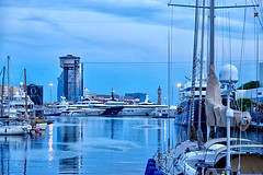 The time when the photographers are getting ready (Fnikos) Tags: port porto puerto harbour harbor sky skyline cloud architecture construction tower sea water waterfront light reflection moll muelle boat sailboat ship barco nightfall nature outdoor