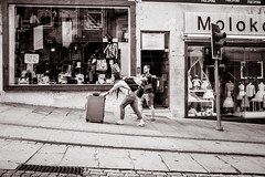 on the move (Gerard Koopen) Tags: portugal porto oporto city tourist people man woman suitcases trafficlight onthemove blackandwhite bw blackandwhiteonly straat street straatfotografie streetphotography candid streetlife fujifilm fuji fujilove x100t 2017 gerardkoopen gerardkoopenphotography