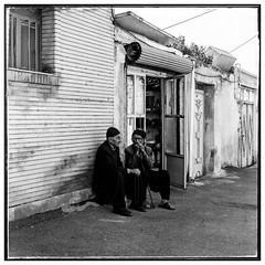 Pace of life (falahatgar_j) Tags: mamiya mamiyac330 iran ilford fp4 ilfordphoto filmphotography black white bw bnwphotography film blackandwhite people urbanphotography deadpanphotography town