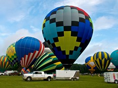 Alabama Jubilee 2018 (deanrr) Tags: alabamajubilee 2018 spring festival colors balloons hotairballoons decaturalabama trucks sky patterns grass wheels inflation hareandhoundrace