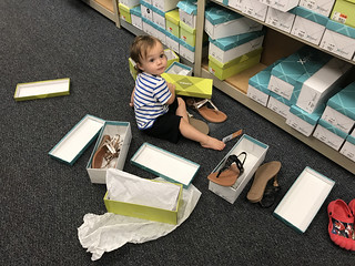 One Little One Year Old Boy Selecting Shoes