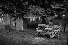 Loved & Remembered (alistair55) Tags: history memories thoughts peaceful bexhill bench graveyard church bwartaward blackwhite